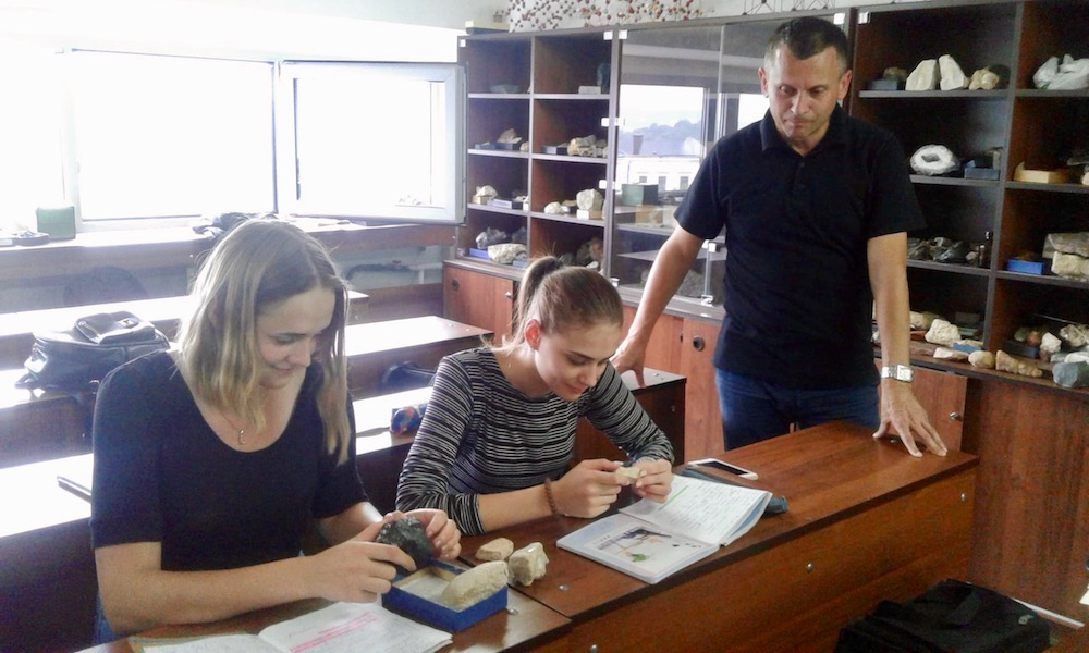 Serhii works with his students on identifying rocks in Lviv, Ukraine