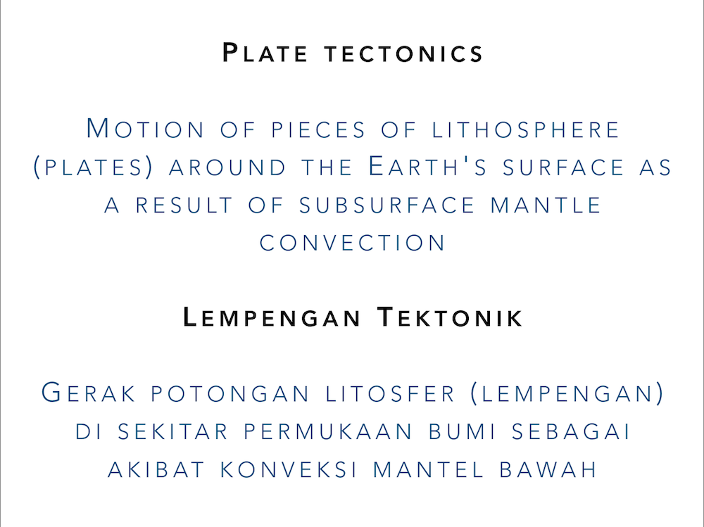 "Slide showing the definition of ""plate tectonics"" in both English and Indonesian"